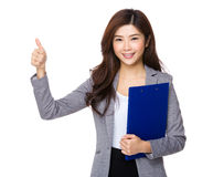Young Asian businesswoman thumbs up with clipboard Stock Photo