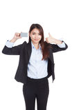 Young Asian businesswoman thumbs up show blank card Stock Image