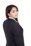 Young Asian businesswoman turn back look at camera Royalty Free Stock Images