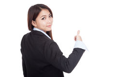 Young Asian businesswoman turn back thumbs up Stock Photo
