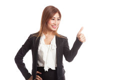 Young Asian businesswoman turn back thumbs up Stock Photos