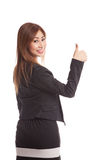 Young Asian businesswoman turn back thumbs up Royalty Free Stock Photos