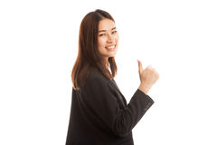 Young Asian businesswoman turn back thumbs up. Stock Photo