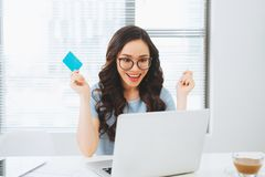 Young asian businesswoman using credit card for on-line payment.  stock photo