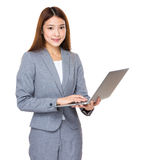 Young asian businesswoman using laptop Stock Images
