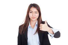 Young Asian businesswoman winks her eye and thumbs up Stock Photos
