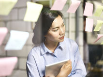 Young asian businesswoman working on business plan Stock Images