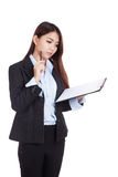 Young Asian businesswoman working with clipboard Stock Photos