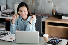 Young asian businesswoman working with laptop computer at office stock photos