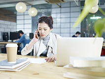 Young asian businesswoman working in office Stock Images
