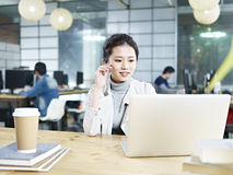 Young asian businesswoman working in office Royalty Free Stock Photography