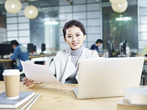 Young asian businesswoman working in office Royalty Free Stock Images