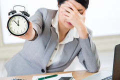 Young asian businesswoman worried about time Stock Photos