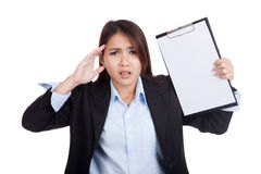 Young Asian businesswoman worry with blank clipboard Royalty Free Stock Image