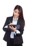 Young Asian businesswoman  write on clipboard Stock Image