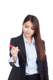 Young Asian businesswoman write with red marker Royalty Free Stock Photo