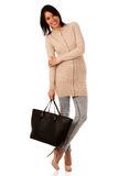 Young asian caucasian woman with briefcase in her hands Stock Images