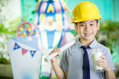 Young asian child holding a glass of milk Royalty Free Stock Photography