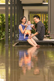 Young Asian Chinese family with 5 month old son Royalty Free Stock Photos
