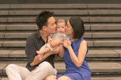 Young Asian Chinese family with 5 month old son Royalty Free Stock Photography