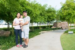 Young Asian Chinese family outdoor. Young Asian Chinese family with baby son enjoying outdoor Stock Photo
