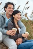 Asian Man Woman Romantic Couple Drinking Takeout Coffee on Beach stock photography
