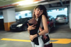Young asian chinese mother traveling the city alone with baby in tow.  royalty free stock photos