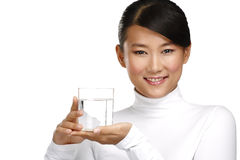 Young asian chinese woman enjoying a glass of water Royalty Free Stock Images