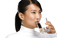 Young asian chinese woman enjoying a glass of water Royalty Free Stock Image