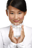 Young asian chinese woman enjoying a glass of water Royalty Free Stock Photos