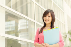 Young Asian college girl student at school campus Stock Photography