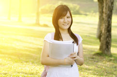 Young Asian college girl student Royalty Free Stock Images