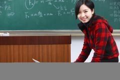One young asian female teacher in the classroom stock images
