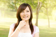 Young Asian college student thinking Stock Images