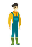 Young asian confident farmer in coveralls. Full length of smiling confident farmer. Farmer standing in a pose signifying confidence. Vector flat design Stock Photos