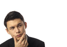 Young Asian Corporate Man Pondering. Over White Background Stock Images