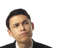 Young Asian Corporate Man Pondering. Over White Background Stock Image