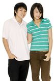 Young Asian Couple. A young asian couple in casual clothes on white background stock photography