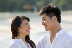 Young Asian couple on the beach Stock Photography