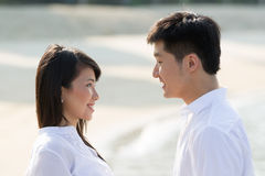 Young Asian couple on the beach Royalty Free Stock Photo