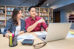 Young asian couple business entrepreneur brainstorm and discussion. For business plan at home office.Conceptual for startup small businesses entrepreneur and Royalty Free Stock Image