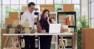 Young Asian couple business working.