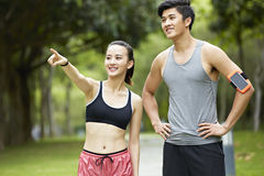 Young asian couple exercising in city park stock images