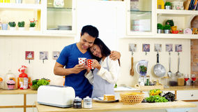 Young asian couple happy with coffee in the kitchen stock image