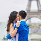 Young Asian couple having a date near the Eiffel Tower, Paris, France Royalty Free Stock Image