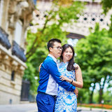 Young Asian couple having a date near the Eiffel Tower, Paris, France Stock Image