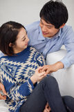 Young Asian couple in home Stock Image