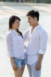 Young Asian couple in love on beach Royalty Free Stock Photo