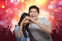 Young asian couple making heart shape with hands Stock Image