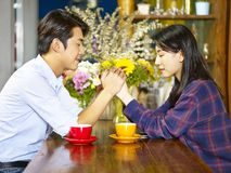 Young asian couple making a wish Royalty Free Stock Photos
